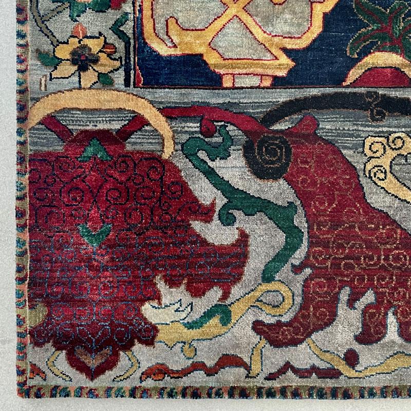 Jewel toned luxury knotted rug