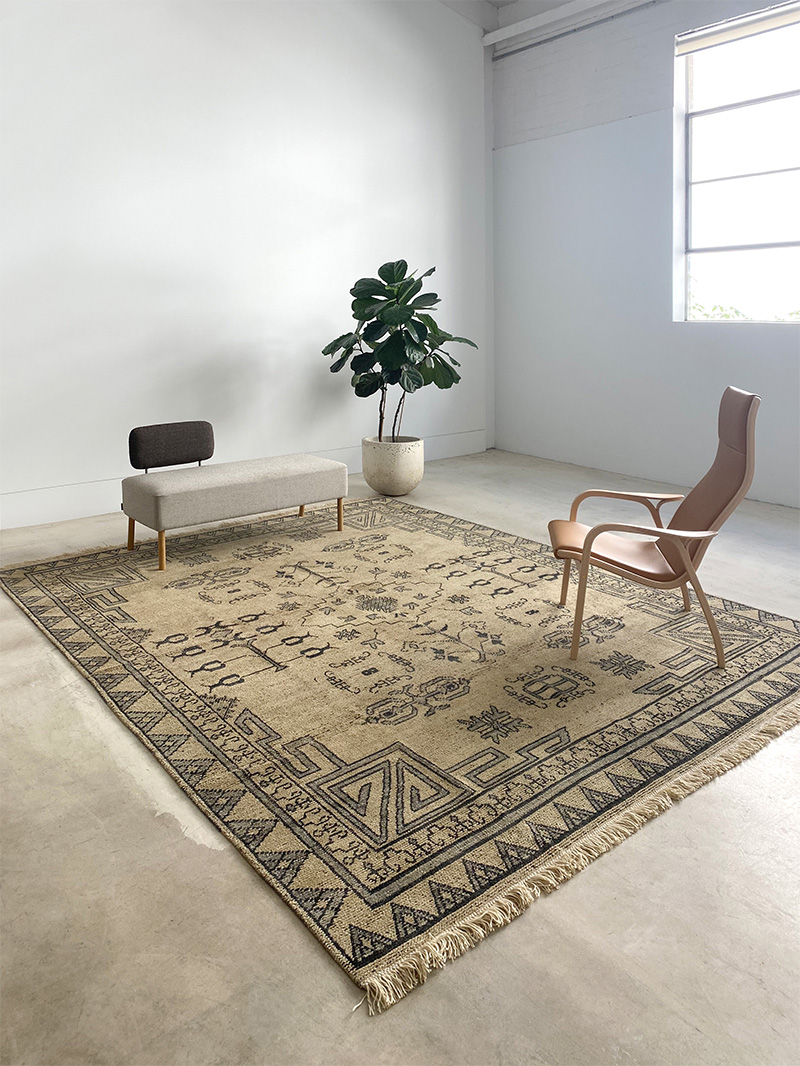 gold and black tribal rug