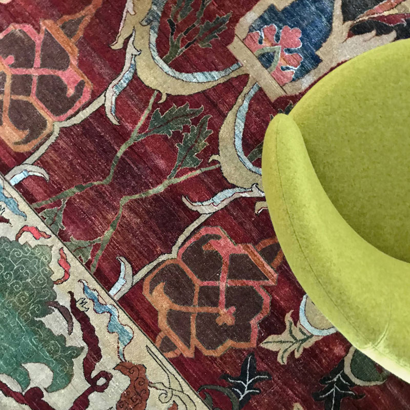 Traditional, rich reds, greens, wool rug