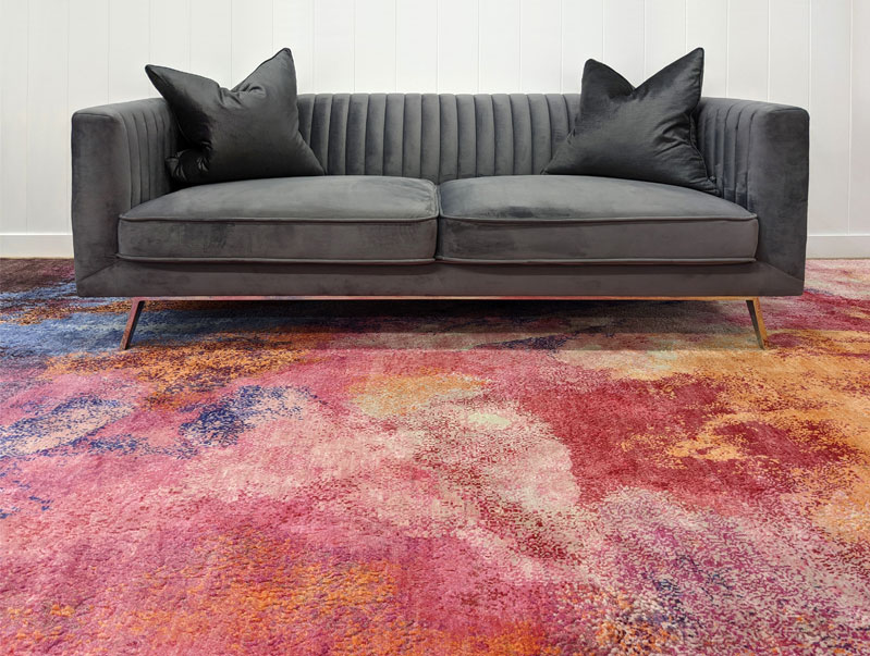 Bold and vivid pink, red and orange luxury rug