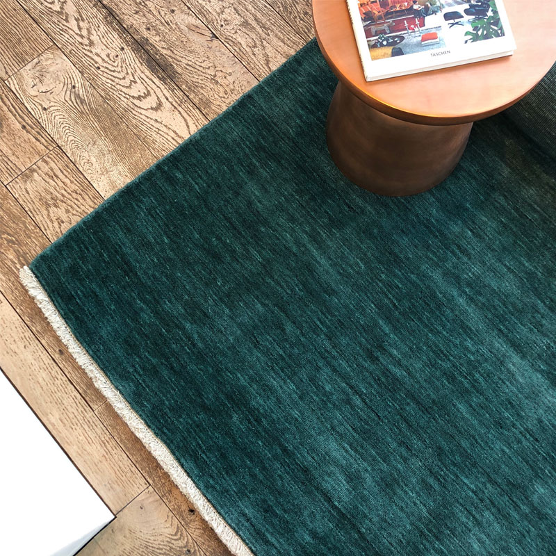Luxurious ombre green rug