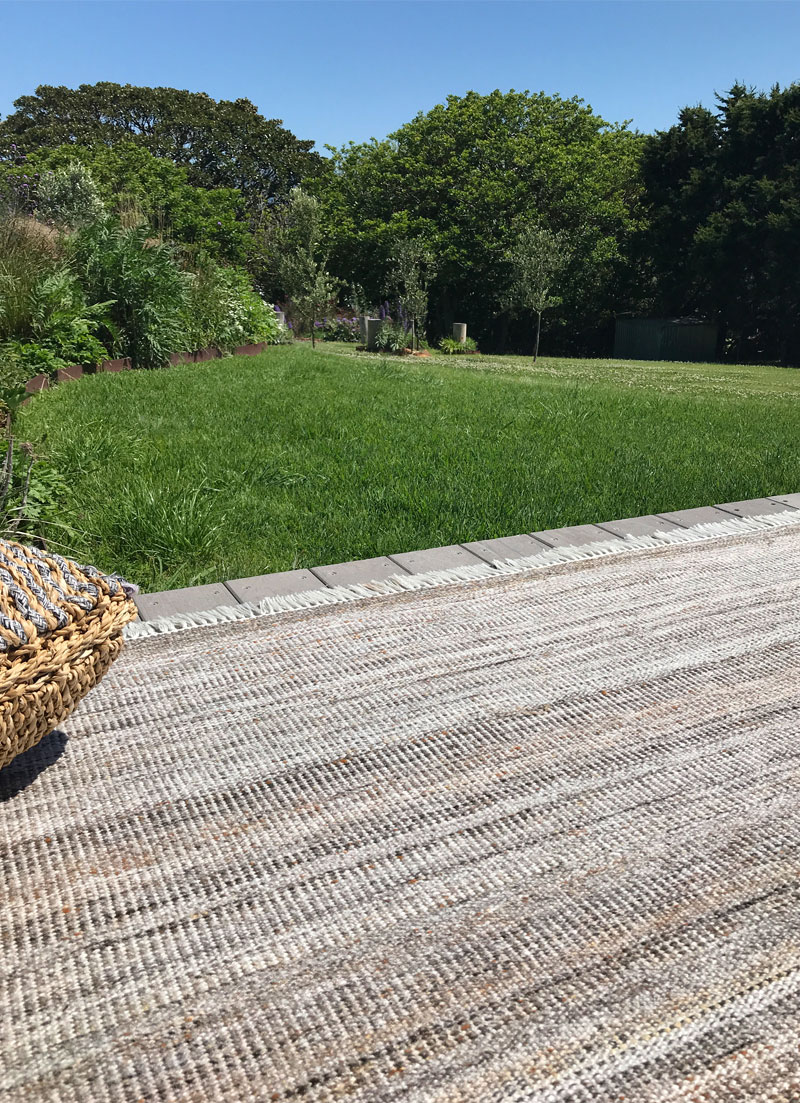 Warm gold and brown outdoor rug