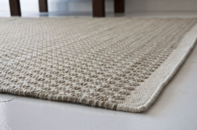 stretching horizontally across this modern and sophisticated new zealand  wool rug it is hand loomed by · herman hand